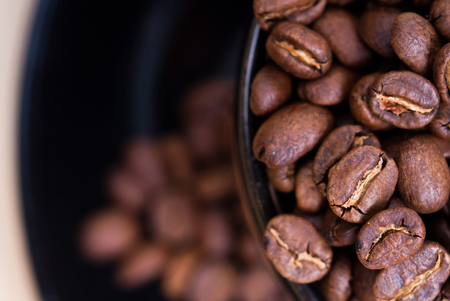 Coffee mug and close-up of coffee beans. Stock Photo