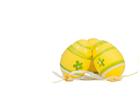 Group of easter yellow eggs, isolated on white.