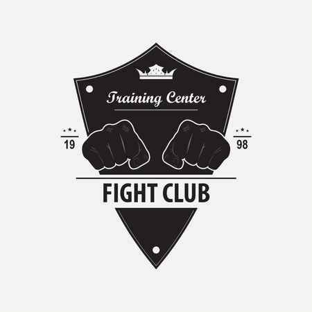 Vector emblem of the fight club with the image of two fists and knights shield. The logo designates the training center for combat training. Illustration