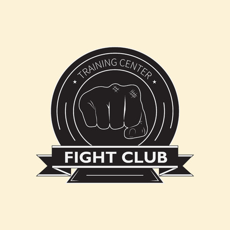 Emblem of the fight club with the image of two fists and knights shield. The logo designates the training center for combat training. Standard-Bild - 109592489