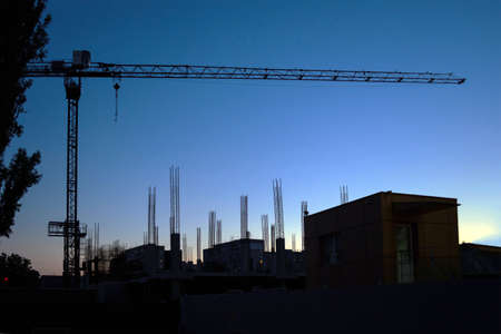 construction of a residential house at sunset, against the background of the already constructed. 版權商用圖片