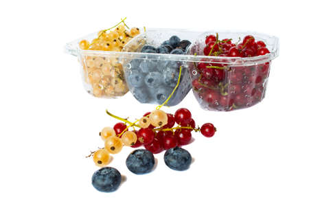 berries of red and white currants and blueberries in plastic packaging 版權商用圖片