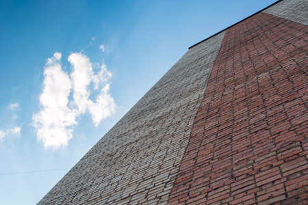 wall of brick high rise building on sky background. Stock Photo - 129005223