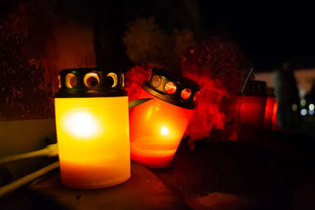 memorial candles in the dark room of the church.