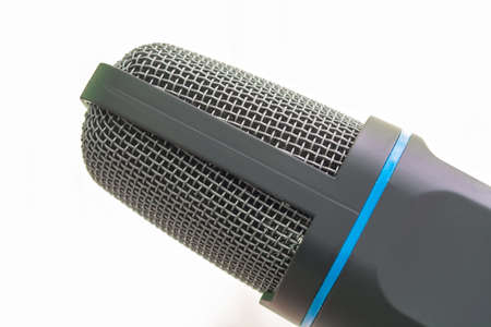 condenser microphone head on a light background.