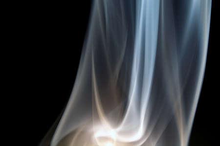 floating, defocused smoke on a black background.