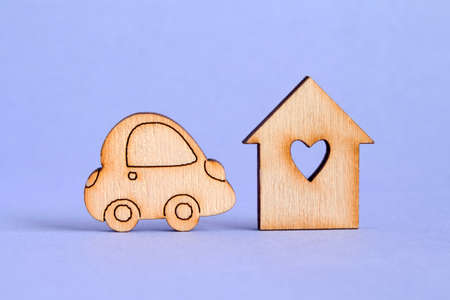 purple car: Wooden house with hole in the form of heart with car icon on purple background.