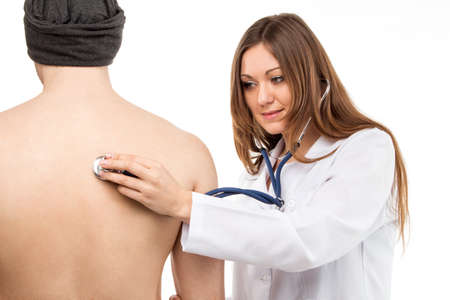 auscultation: Female young doctor holding patients lung auscultation with blue phonendoscope.