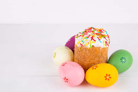 sweetstuff: Easter cake with colorful eggs on white wooden background. Stock Photo