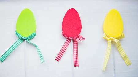 Three decorative colorful flat easter eggs on white background. Stock Photo