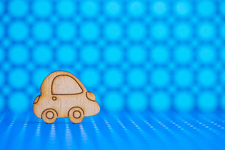 Wooden car icon on blue spotted background. Concept of moving. Symbol of traveling. Stock Photo