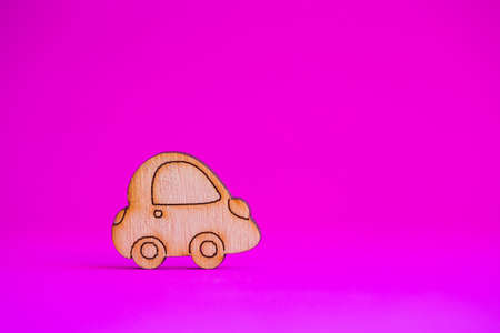 Wooden car icon on pink crimson background. Concept of moving. Symbol of traveling.