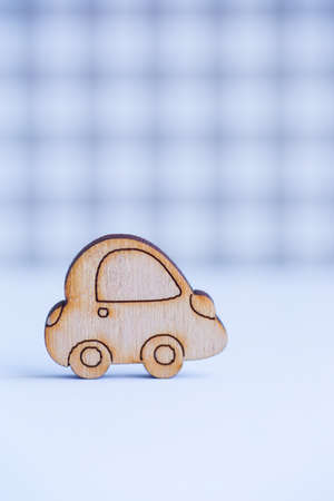 Wooden car icon on gray checkered background. Concept of moving. Symbol of traveling. Stock Photo