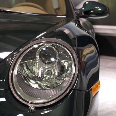 Headlight and detail on a sports car        Stock Photo - 4741753