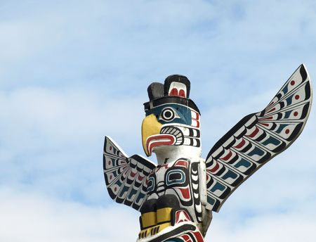 Detail of a North American Totem Pole against a blue sky    Stock Photo - 4741743