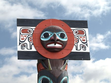 canada aboriginal: Detail of a North American Totem Pole against a blue sky