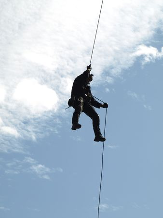 SWAT team member rappelling at counter terrorism training      Stock Photo