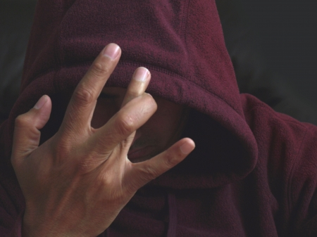 Gang member with a hand sign photo