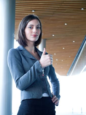 Successful professional businesswoman with thumbs up Stock Photo - 5597782