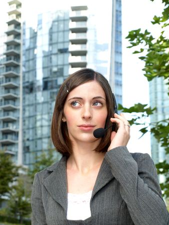 Attractive young businesswoman with headset photo