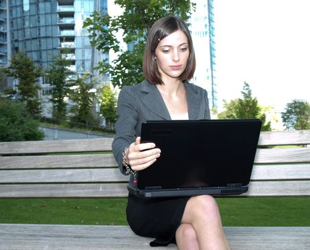 Young businesswoman using a laptop computer Stock Photo - 5671170