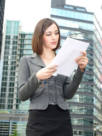 Young businesswoman reading documents photo