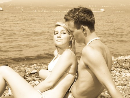 Young attractive couple at the beach photo