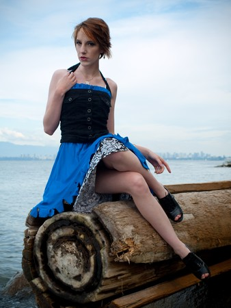 edgy: Young and edgy fashion model posing for the camera wearing a fashion dress and corset