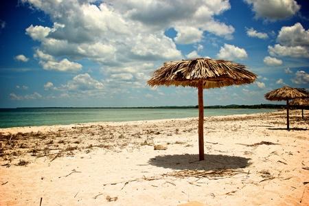 sun roof: Vacation Concept  Palapa Sun Roof Beach Umbrella in a caribbean white sandy beach