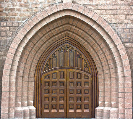 Main entrance to catolic church in gothic style photo