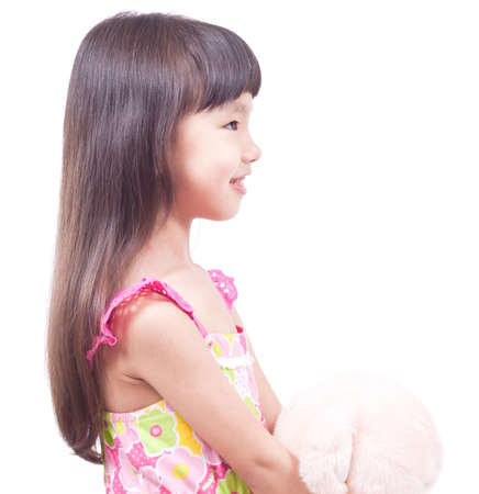 Little cute girl with friend pink toy Studio isolated profile shoot photo