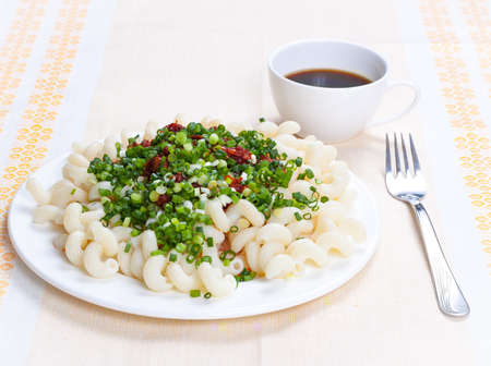 sause: Pasta with tomato sause, meat, spring onion on white dish  As decoration linen table-cloth