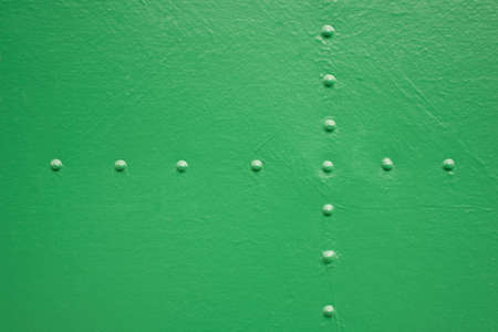 Old painted metal with rivets painted in green Stock Photo
