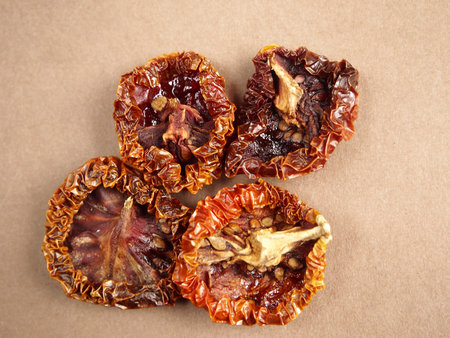 sundried: Sundried tomatoes on brown background Stock Photo