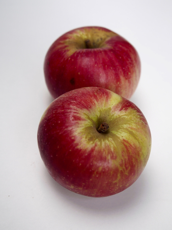 pome: Two isolated akane apple Stock Photo