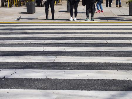 People waiting in crosswalk