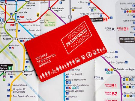 Madrid - Spain, June 19 - 2018  Public transport card of Madrid on underground map of Madrid