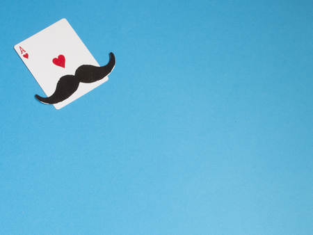 Mustache and ace hearts card on blue background