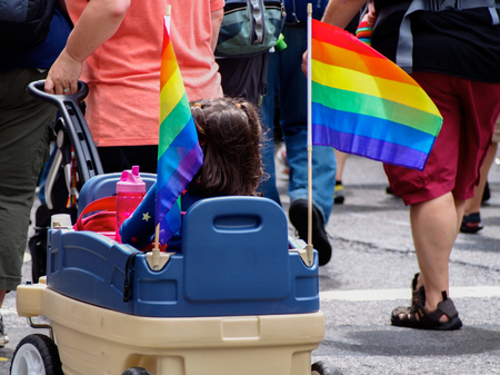 Unrecognizable girl in a small car in the New York gay parade Stock fotó