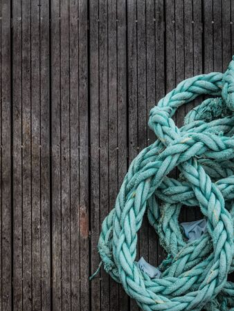 Sailing background - Blue grunge rope on wood background with copy space Фото со стока