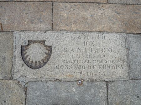 Plaque on Kilometer 0 at Obradoiro square with text in spanish Way of Santiago - European Cultural Route - Council of Europe Фото со стока