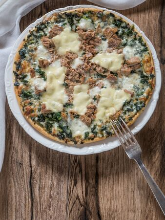 Pizza of tuna and spinach with copy space