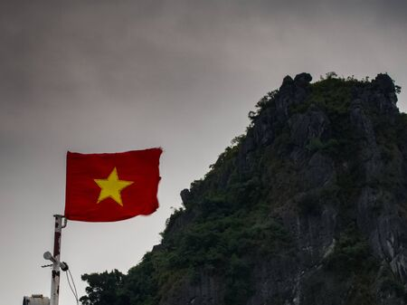 Vietnamese flag  with mountain in Halong Фото со стока