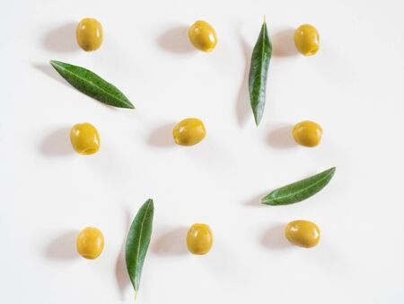 Pitted olives pattern on white background