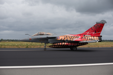 Schleswig - Jagel, Germany - June 19, 2014: French Air Force Dassault Rafale board number113-GU is taxiing. The plane has a special painter for MTM2014