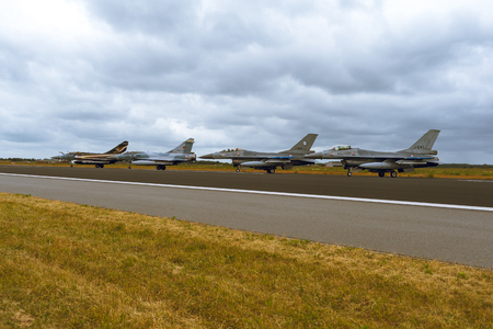 Schleswig - Jagel, Germany - June 19, 2014: Two Netherlands - Air Force F-16 Fighting Falcon and two French Air Force Dassault Mirage 2000 is taxiing during Tiger Meet 2014.