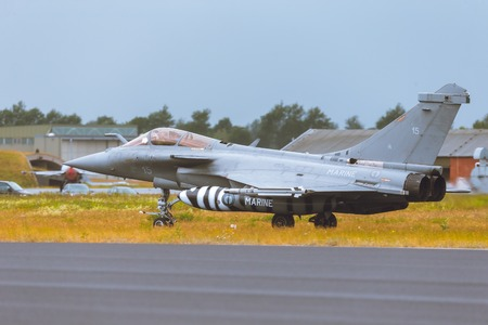 Schleswig - Jagel, Germany - June 19, 2014: Schleswig - Jagel, Germany - June 19, 2014: Dassault Rafale board number 15 taxiing on runway after landing during Tiger Meet 2014 Editorial