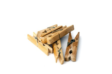 pile of wooden clothespins isolated on white background