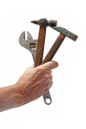 wrench and 2 hammers in hand as gift or flowers