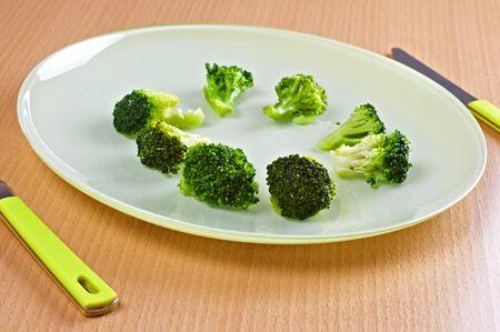 Green broccoli in green dish  Stock Photo